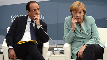 France's President Francois Hollande and Germany's Chancellor Angela Merkel (AFP Photo / Eric Feferberg)