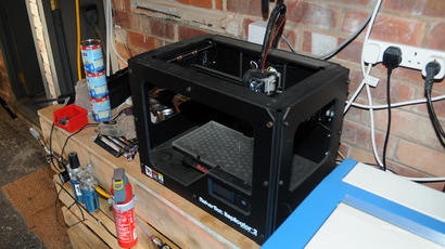 A handout picture taken on October 24, 2013 and released by Greater Manchester Police on October 25, 2013 shows a 3D printer seized by British police during an operation that also resulted in the seizure of plastic 3D components that police believe could be used to make a viable 3D-printed gun in the Baguley area of Manchester, northwest England on October 24, 2013. (AFP Photo)