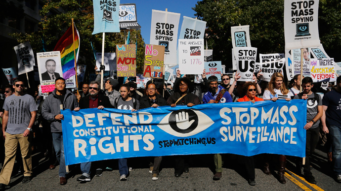 "Demonstarators carry signs at ""Stop Watching Us: A Rally Against Mass Surveillance"" march near the U.S. Capitol in Washington, October 26, 2013. (Reuters / Jonathan Ernst)"