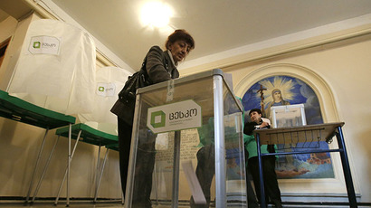 A voter casts her ballot at a polling station during the presidential election in Tbilisi, October 27, 2013. (Reuters / Grigory Dukor)