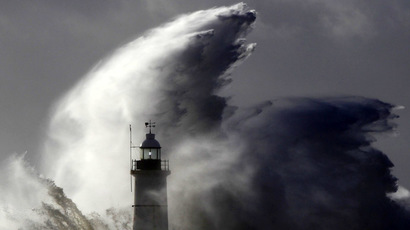 Waves crash against a lighthouse during storms that battered Britain and where a 14-year-old boy was swept away to sea at Newhaven in South East England October 28, 2013. (Reuters/Luke MacGregor)