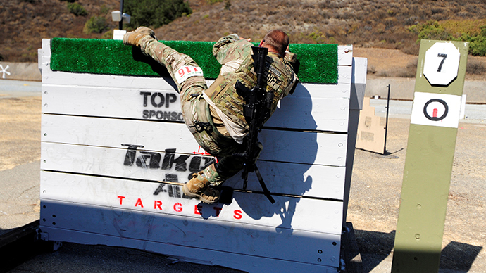 An officer competes during the Best in the West 2013 Invitational S.W.A.T. Competition (Reuters / Josh Edelson)
