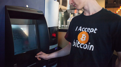 World's first bitcoin ATM on October 29, 2013 at Waves Coffee House in Vancouver, British Columbia (AFP Photo / David Ryder)