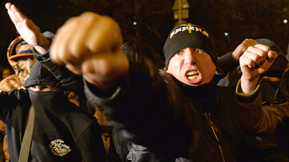 Russian ultra-nationalists shout slogans during a protest in the Biryulyovo district of Moscow, late on October 13, 2013. (RIA Novosti / Iliya Pitalev)