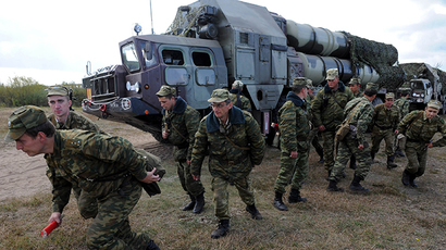 Belarussian soldiers near an S-300 surface-to-air missile complex using during the joint Russian-Belarussian military exercises. (AFP Photo / Viktor Drachev)