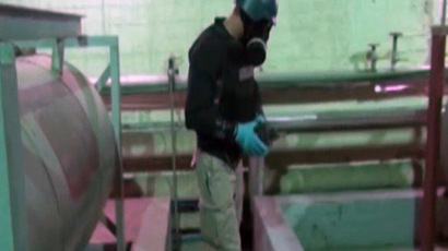 An image grab taken from Syrian television shows an inspector from the Organisation for the Prohibition of Chemical Weapons (OPCW) at work at an undisclosed location in Syria (AFP Photo/Syrian television )