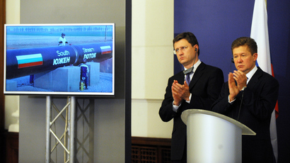 Russian Minister of Energy Alexander Novak (L) and Russian energy group Gazprom CEO Alexey Miller (R) applaud the start of the construction of the Bulgarian section of Russian gas giant Gazprom's South Stream pipeline on October 31, 2013 in Sofia (AFP Photo / Nikolay Doychinov)
