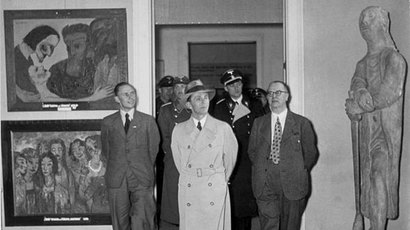 Joseph Goebbels views the Degenerate Art exhibition in Munich, 1937. (Photo by German Federal Archives)