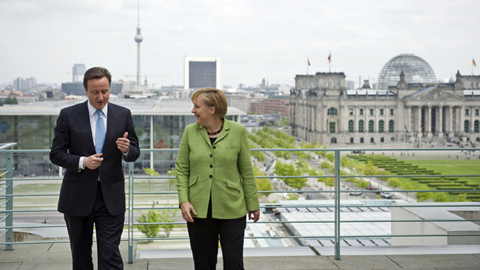 German Chancellor Angela Merkel speaking with British Prime Minister David Cameron on the terrace of the Chancellery with the TV tower and Reichstag in the background in Berlin (AFP Photo)