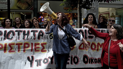 Protesters shout slogans outside the Greek Finance Ministry during the meeting of the Greek Finance Minister with the EU and IMF officials in Athens, 2013. (AFP Photo/Aris Messinis)