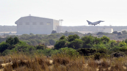 A Typhoon jet of the British Royal Air Force (RAF) lands at a British base at Akrotiri, near the city of Limassol August 29, 2013. (Reuters/Yiannis Nisiotis)