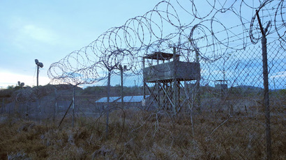 An abandoned camp and tower at the US Naval Base in Guantanamo Bay, Cuba on August 8, 2013.  (AFP Photo/Chantal  Valery)