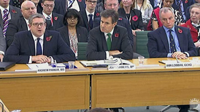 A screen grab from the UK's Parliamentary Recording Unit (PRU) shows from (L-R) Britain's Andrew Parker, director general of domestic intelligence agency MI5, the head of its foreign counterpart MI6, John Sawers, and Iain Lobban, head of electronic eavesdropping agency GCHQ, during a questioning hearing by parliament's Intelligence and Security Committee in London on November 7, 2013. (AFP/PRU)