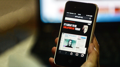 Activist hacker group Anonymous is seen through the internet government website of Singapore Prime Minister Office circulated online on a smartphone in Singapore on November 7, 2013. (AFP Photo / Roslan Rahman)