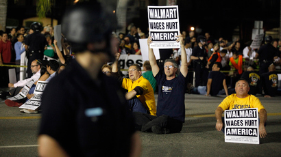 More than 50 protesters sit in the middle of the road before being arrested during a protest for better wages outside Wal-mart in Los Angeles, November 7, 2013. (Reuters / Lucy Nicholson)