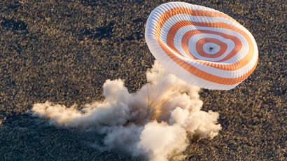 The Soyuz TMA-09M capsule carrying the International Space Station (ISS) crew of U.S. astronaut Karen Nyberg, Russian cosmonaut Fyodor Yurchikhin and Italian astronaut Luca Parmitano lands in a remote area near the town of Zhezkazgan in central Kazakhstan November 11, 2013.(Reuters / Shamil Zhumatov)