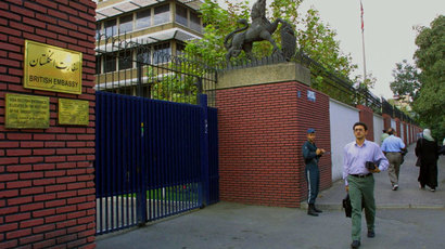 Iranians walk past the British embassy in Tehran 24 September 2001.(AFP Photo / Behrouz Mehri)