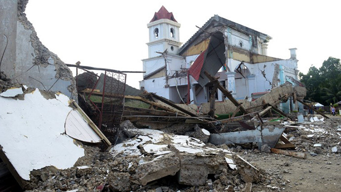 (FILE) This photo taken on October 17, 2013 shows the destroyed historic St Michael Parish church in Clarin in the central Philippine island of Bohol, damaged during a 7.1 magnitude quake that hit the area on October 15. (AFP Photo / Jay Directo)