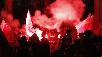 Far-right protesters light flares in front of the building of Russian embassy during the annual far-right march, which coincides with Poland's national Independence Day in Warsaw November 11, 2013. (Reuters / Kacper Pempel)