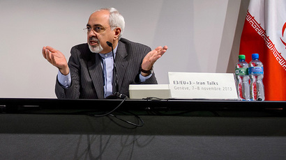 Iranian Foreign Minister Mohammad Javad Zarif gestures during a final press conference closing the third day of talks on Iran's nuclear programme, on November 10, 2013 in Geneva. (AFP Photo / Fabrice Coffrini)