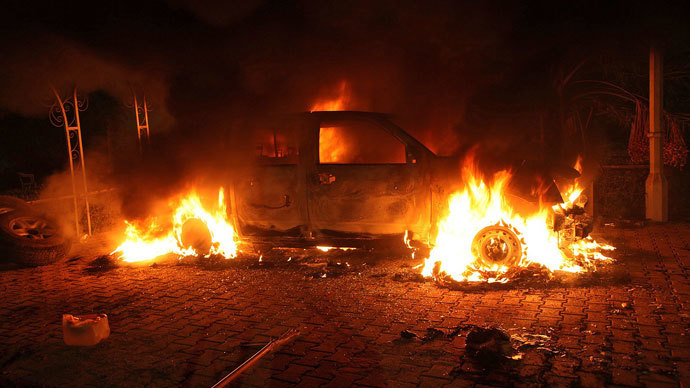 A vehicle and the surrounding area are engulfed in flames after it was set on fire inside the US consulate compound in Benghazi late on September 11, 2012.(AFP Photo / STR)