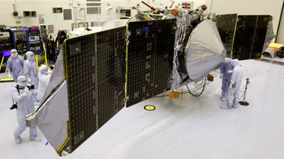 Technicians work on NASA's next Mars-bound spacecraft, the Mars Atmosphere and Volatile Evolution (MAVEN) spacecraft, as it is displayed for the media at the Kennedy Space Center in Cape Canaveral, Florida (Reuters / Joe Skipper)