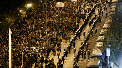 Protesters march outside the U.S embassy during a rally marking the anniversary of the 1973 student uprising against Greece's former military dictatorship, in Athens November 17, 2013. (Reuters / John Kolesidis)