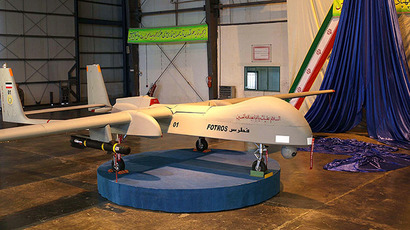 "An Iranian made missile-equipped drone dubbed ""Fotros"", is unvieled during a ceremony in Tehran on November 18, 2013. (AFP Photo / ISNA)"