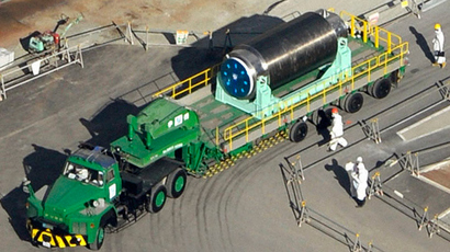 The cask containing 22 fuel rods at the No. 4 reactor building on a trailer, is moved from the reactor building to another building where a common fuel pool is located, at the tsunami-crippled TEPCO's Fukushima Daiichi nuclear power plant in Fukushima prefecture, in this photo taken by Kyodo November 21, 2013. (Reuters / Kyodo)