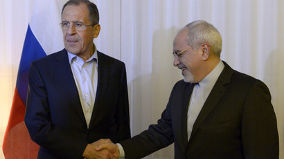 Russian Foreign Minister Sergei Lavrov and Iranian Foreign Minister Mohammad Javad Zarif, right, during a meeting in Geneva. (RIA Novosti/Eduard Pesov)