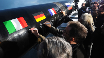 Shareholders and partners of Gazprom's project sign on the first pipe abut during the launching ceremony of South Stream gas pipeline construction. (RIA Novosti/Ramil Sitdikov)