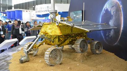 "File photo taken on November 5, 2013 shows a model of a lunar rover named ""Jade Rabbit"" in a nod to Chinese folklore that will explore the moon's surface in an upcoming space mission is seen on display at the China International Industry Fair 2013 in Shanghai. (AFP Photo/Peter Parks)"