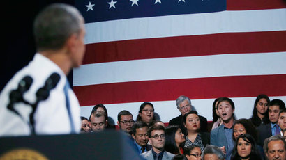 An anti-deportation protester (C) in the audience shouts against U.S. President Barack Obama (L), stopping him temporarily from delivering remarks during event on immigration reform in San Francsico, November 25, 2013.(Reuters / Jason Reed)