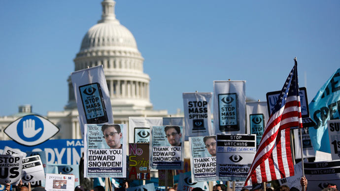 "Demonstrators hold up their signs during the ""Stop Watching Us: A Rally Against Mass Surveillance"" march near the U.S. Capitol in Washington, October 26, 2013 (Reuters / Jonathan Ernst)"