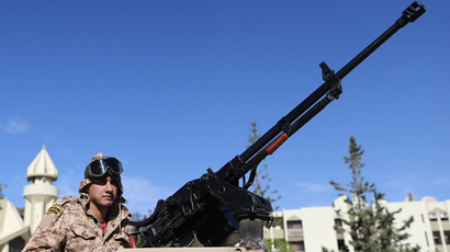 A member of the Libyan army guards the streets following yesterday's clashes in Benghazi November 26, 2013 (Reuters / Esam Omran Al-Fetori)