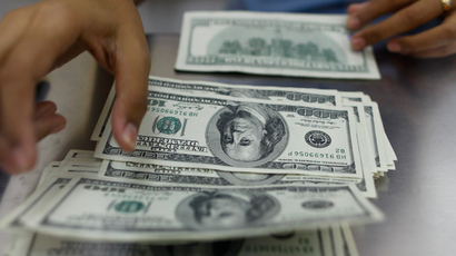 ​US may end controversial five-year 'easy money' program in October