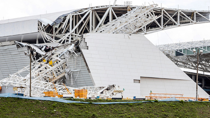 View of damages at the Arena de Sao Paulo --Itaquerao do Corinthians-- stadium, still under construction, after a crane fell across part of the metallic structure, on November 27, 2013 in Sao Paulo (AFP Photo / Miguel Schincariol)