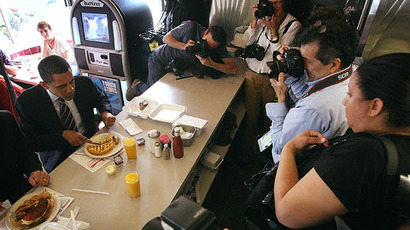 US President Barack Obama is surrounded by photographers while he eats breakfast. (AFP Photo / Scott Olson)