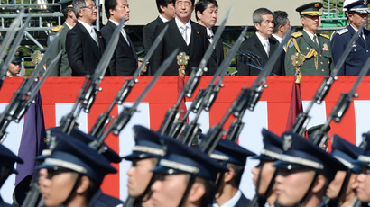 Japanese Prime Minister Shinzo Abe (top C) inspects troops of Japan's Self-Defence Force  (AFP Photo / Toru Yamanaka)