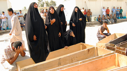 ARCHIVE PHOTO: Women react near empty coffins as they wait to claim the bodies of their relatives, who were killed by gunmen, outside a hospital morgue in Mahmudiya, 30 km south of Baghdad, September 4, 2013 (REUTERS / Ibrahim Jassam)