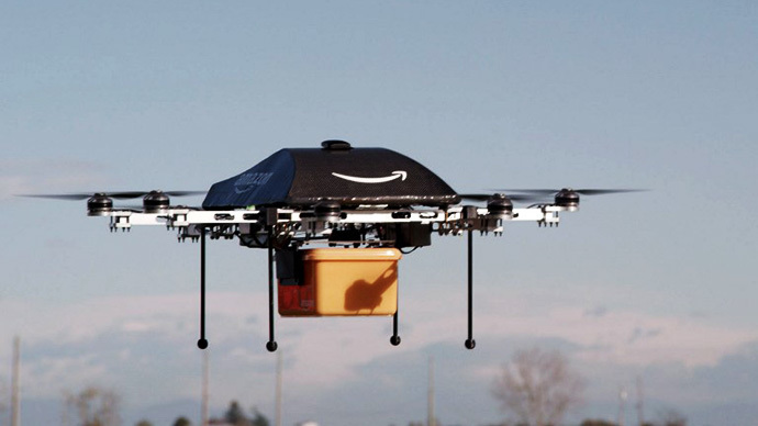 "This undated handout photo released by Amazon on December 1, 2013 shows a flying ""octocopter"" mini-drone that would be used to fly small packages to consumers. (AFP Photo / Amazon)"