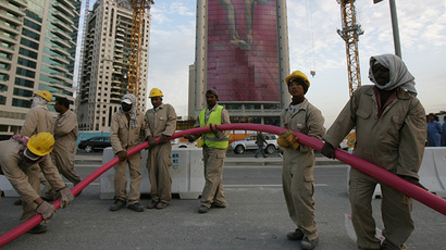 Workers in Doha, Qatar. (AFP Photo / Goh Chai Hin)
