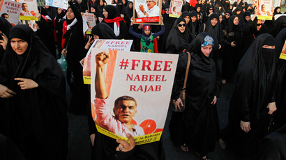 Women protesters holding posters of Nabeel Rajab and Ibrahim Sharif demand for their release during an anti-government march organised by al-Wefaq opposition party in Budaiya, west of Manama, Bahrain August 31, 2012. (Reuters / Hamad I Mohammed)