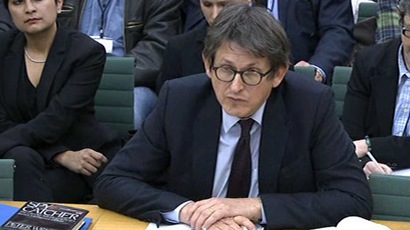 A video grab made from footage broadcast by the UK Parliament's Parliamentary Recording Unit (PRU) via Parliament TV on December 3, 2013 shows the editor of Britain's Guardian newspaper, Alan Rusbridger, giving evidence before the government's Home Affairs Select Committee in London on December 3, 2013. (AFP/PRU)