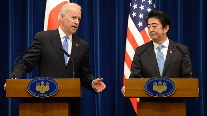 US Vice President Joe Biden (L) gestures as he speaks during a joint press conferene with Japanese Prime Minister Shinzo Abe (R) after their meeting at Abe's official residence in Tokyo on December 3, 2013 (AFP Photo / Toru Yamanaka)