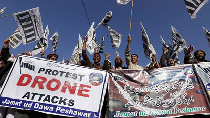 Supporters of Pakistan's banned Islamic group Jamaat-ud-Dawa (JuD) carry banners and shout anti-US slogans during a protest against US drone strikes in Pakistan's tribal region, in Peshawar on November 29, 2013.(AFP Photo / A Majeed)