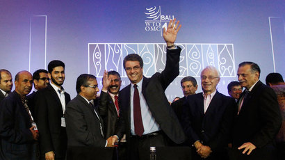 Director-General Roberto Azevedo gestures as he is congratulated by delegates after the closing ceremony of the ninth World Trade Organization (WTO) Ministerial Conference in Nusa Dua, on the Indonesian resort island of Bali December 7, 2013.(Reuters / Edgar Su)