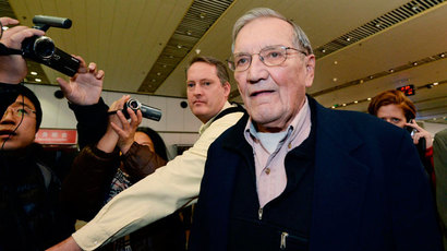 Veteran U.S. soldier Merrill Newman (C), who was detained for over a month in North Korea, arrives at Beijing airport in Beijing, in this photo taken by Kyodo December 7, 2013. (Reuters / Kyodo)