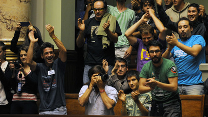 People celebrate after the Uruguayan senate approved a law legalizing marijuana in the Legislative Palace in Montevideo, on December 10, 2013. (AFP Photo/Miguel Rojo)