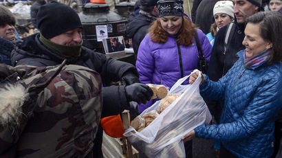 A handout picture released on December 10, 2013 by Ukrainian Union Opposition press services hows US Assistant secretary of State for European and Eurasian Affairs Victoria Nuland (R) distributing cakes to protesters on the Independence Square in Kiev on December 10, 2013. (AFP Photo/Andrew Kravchenko)